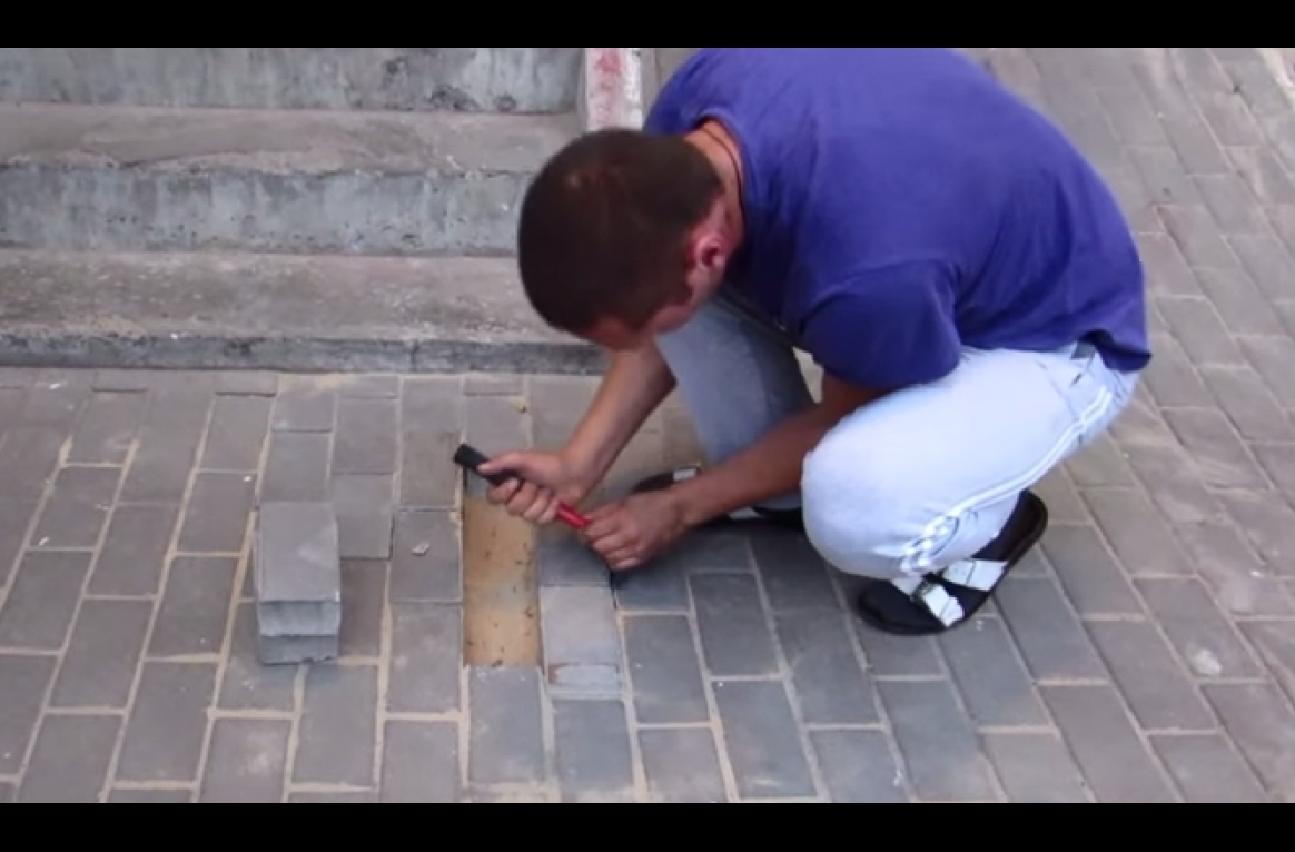 He heard something cries beneath the sidewalk, so he opened it. What came out was horrifying