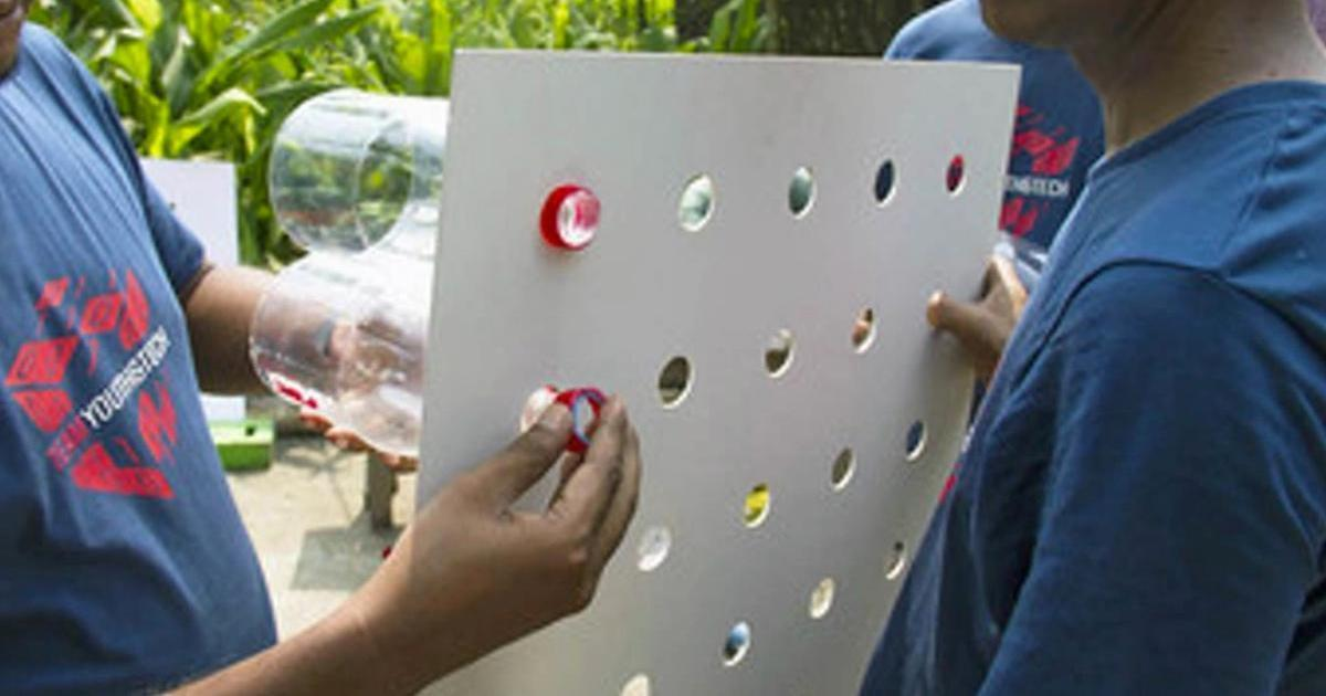 He connected plastic bottles to a cardboard and put it on the window, for a genius reason!