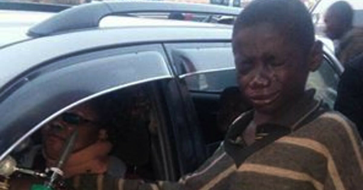 A boy went to a car to ask for money - so he looked inside and started bursting in tears