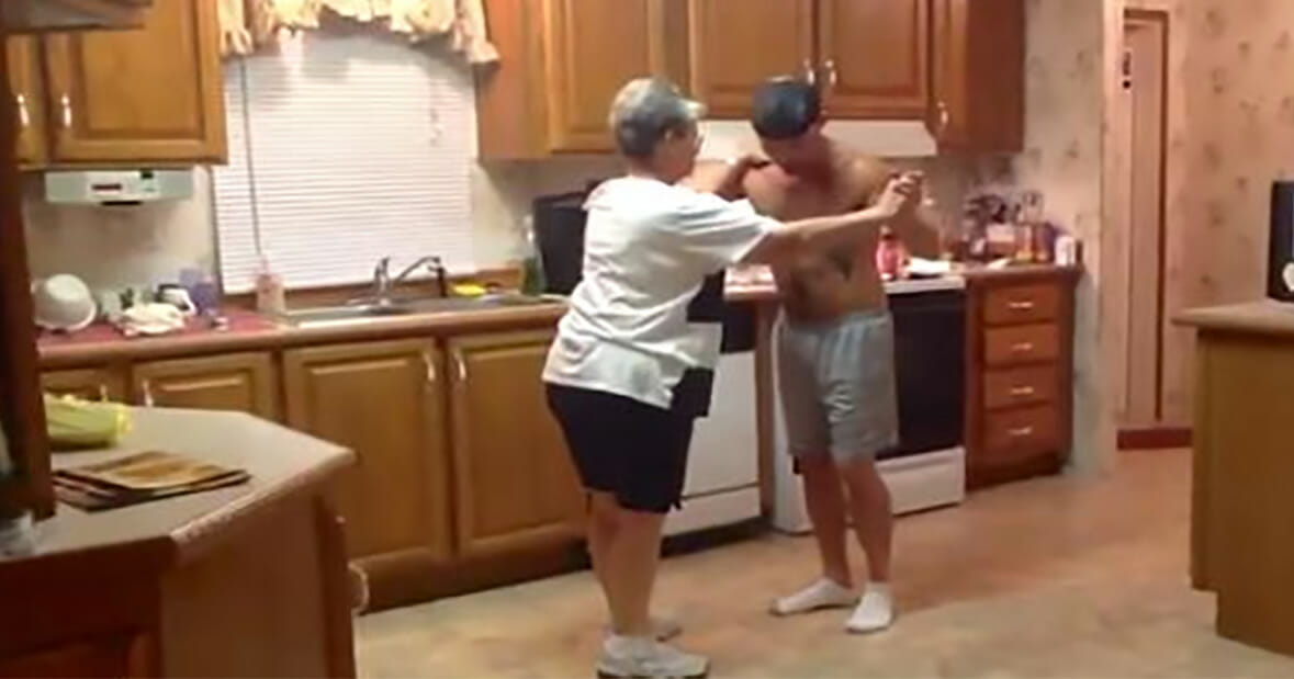 Son took his mother's hand when the favorite song began to play - now watch the dance that conquered the internet by storm